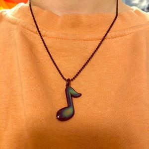 """Color changing, """"Mood"""", music note necklace."""